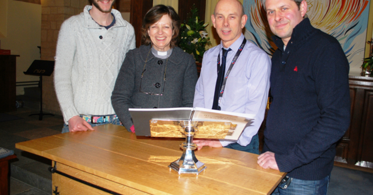 Bucks New University graduate Sam Hutchings; Reverend Jane Chaffey, and Bucks New University Lecturers David Gillett and Alex Hellum, with the oak altar table.