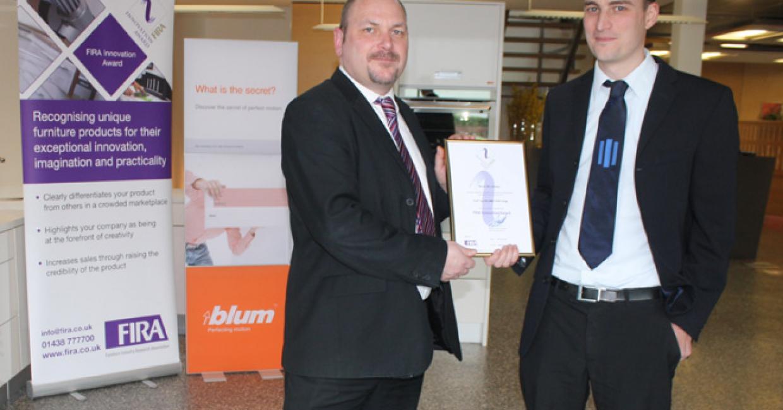FIRA CEO Phil Reynolds (left) presents Blum UK's James Farmer with the Innovation Award