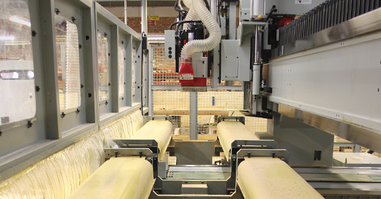 Fixed bridge and moving table configuration provides easy access to the machine