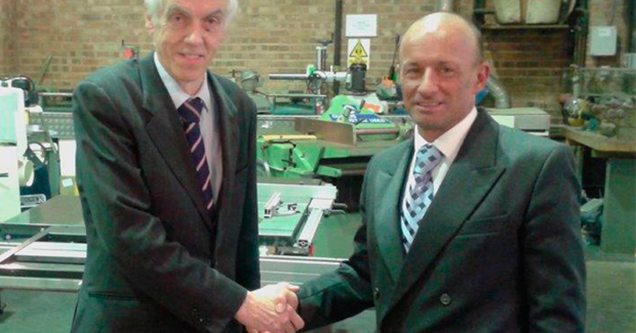 Francis Dalton (left) and Valentino Villa shake hands on their agreement during Valentino's recent visit to the Daltons Wadkin headquarters in Nottingham