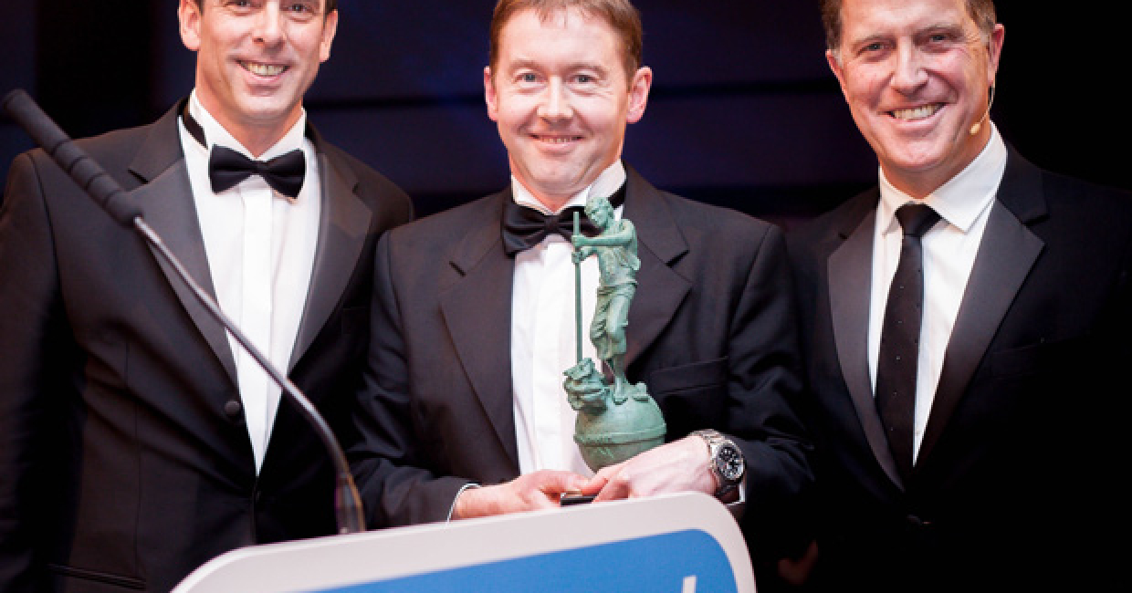 Combilift's Mark Whyte (centre) accepting the award.