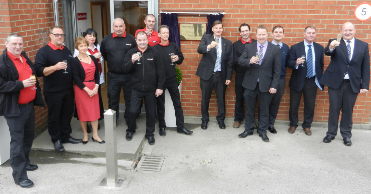 The Schelling UK team outside the reception area of the new premises