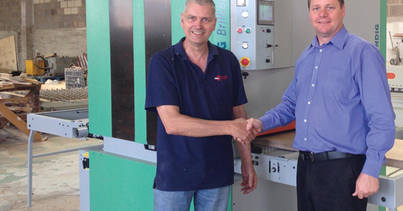 Brian Bourne (left) of Sawtec hands over the Kündig Brilliant sander to Ian Matthews of Hi-tec Joinery
