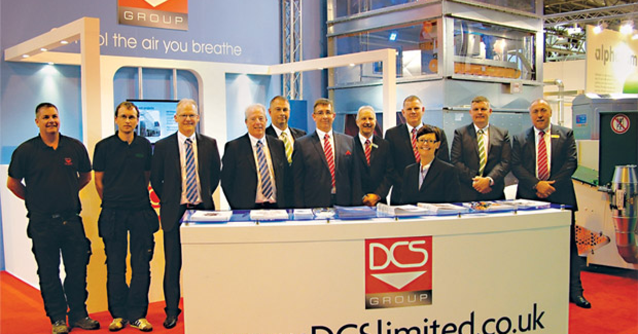 All smiles for the DCS team, overlooked by the impressive Ecovar Validus model