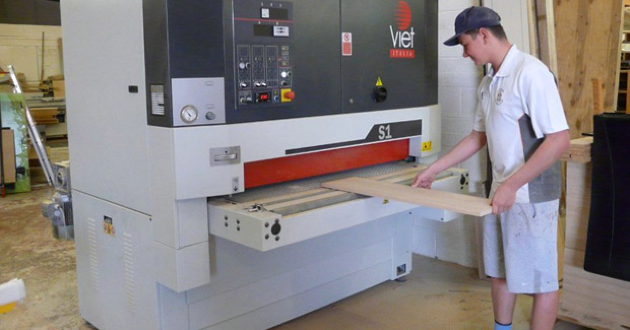 The Viet S1 sander is used to sand down lippings on shelving panels