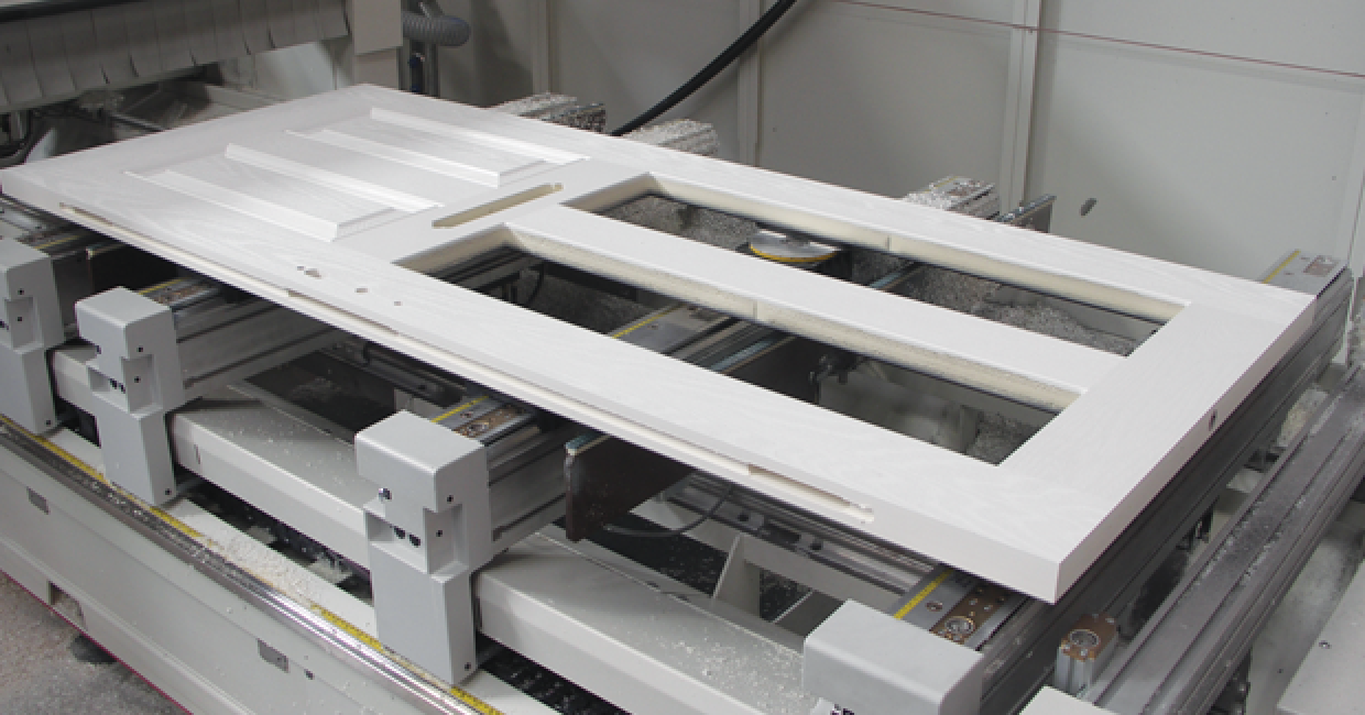 Machined composite door on frame fast's SCM Accord CNC machining centre