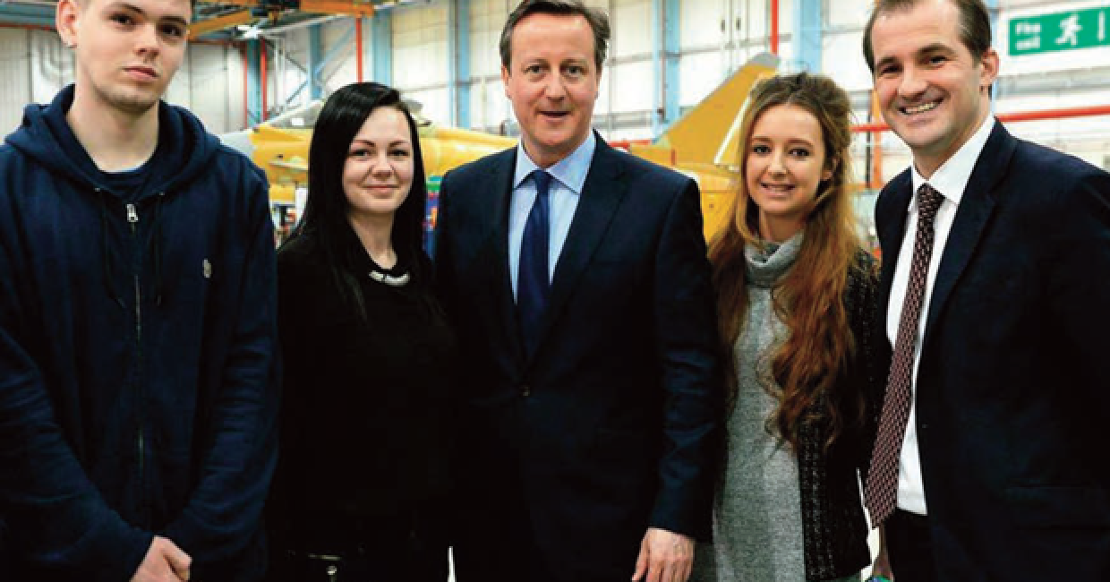 Apprentices from JJO plc, from left Zak Craven, Megan Bateson and Anne Levelle with Rossendale & Darwen MP Jake Berry and Prime Minister David Cameron at BAE Systems in Warton, Preston