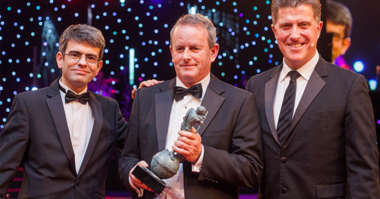 Robert Moffett, centre, receiving the Lifetime Achievement award