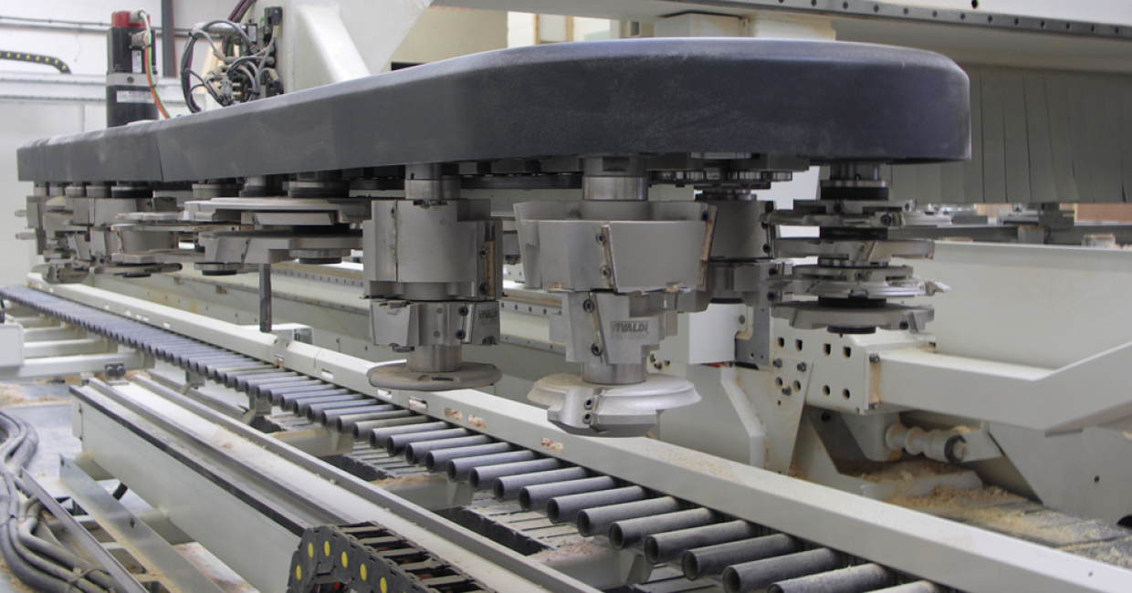 The 48-station tool-changer and component roller conveyor