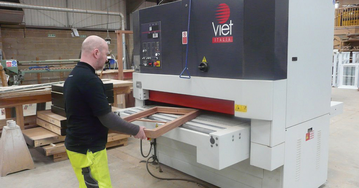 A window frame is put into the Viet sander at Scope Joinery