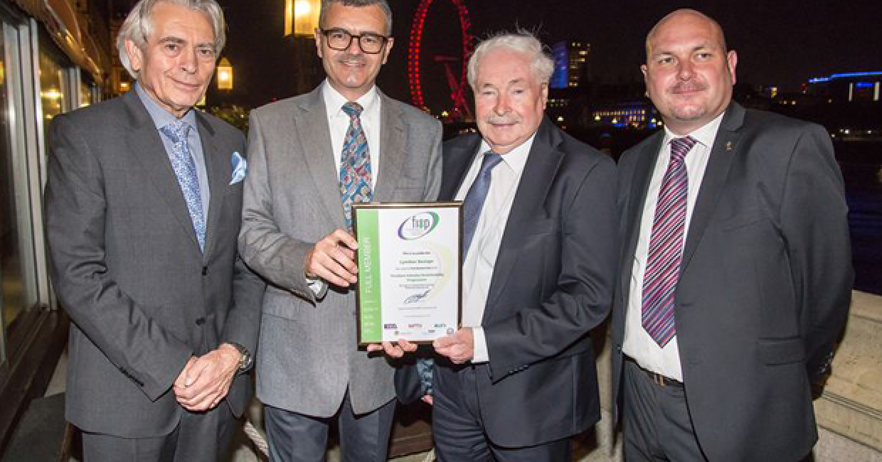 Tim Armitt, managing director of Lyndon Design (second left) receives the company's FISP membership certification.