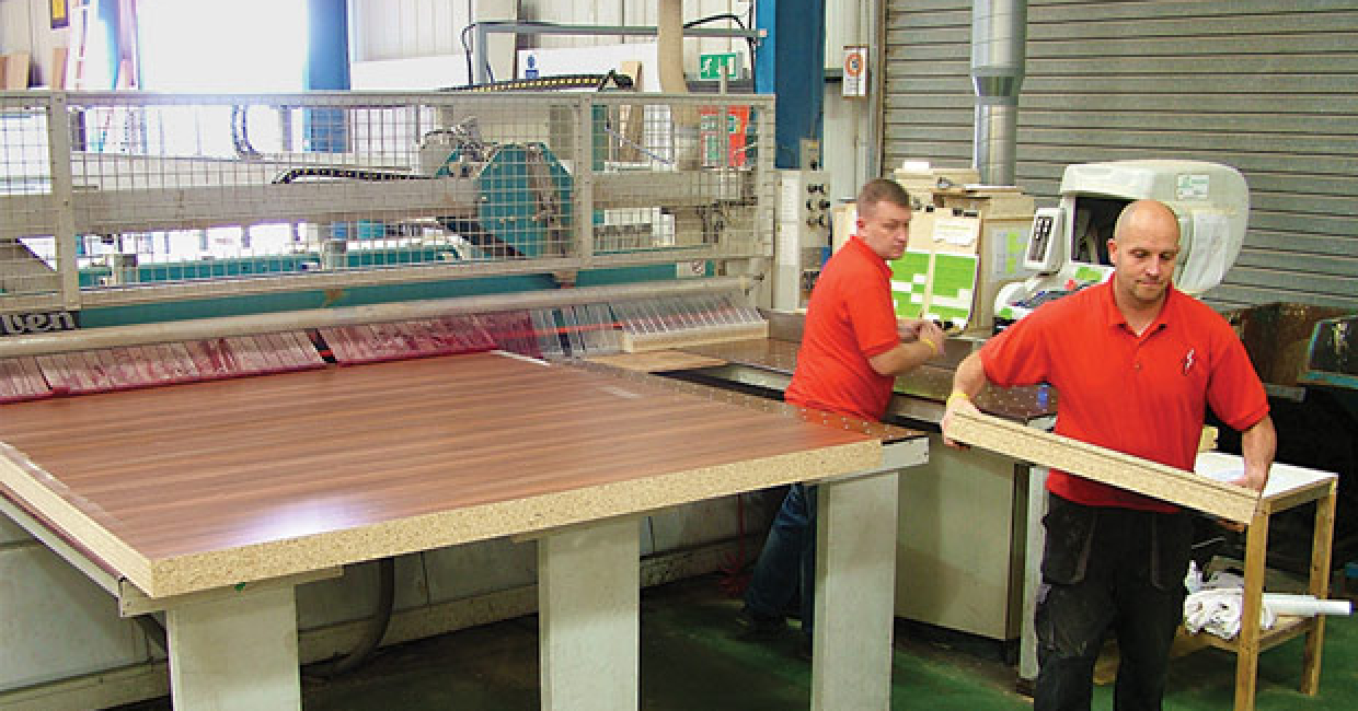 Team leaders, Leigh Sutherby and Craig Greaves, processing insulation panels at the beam saw which is fitted with an automatic Ecogate damper
