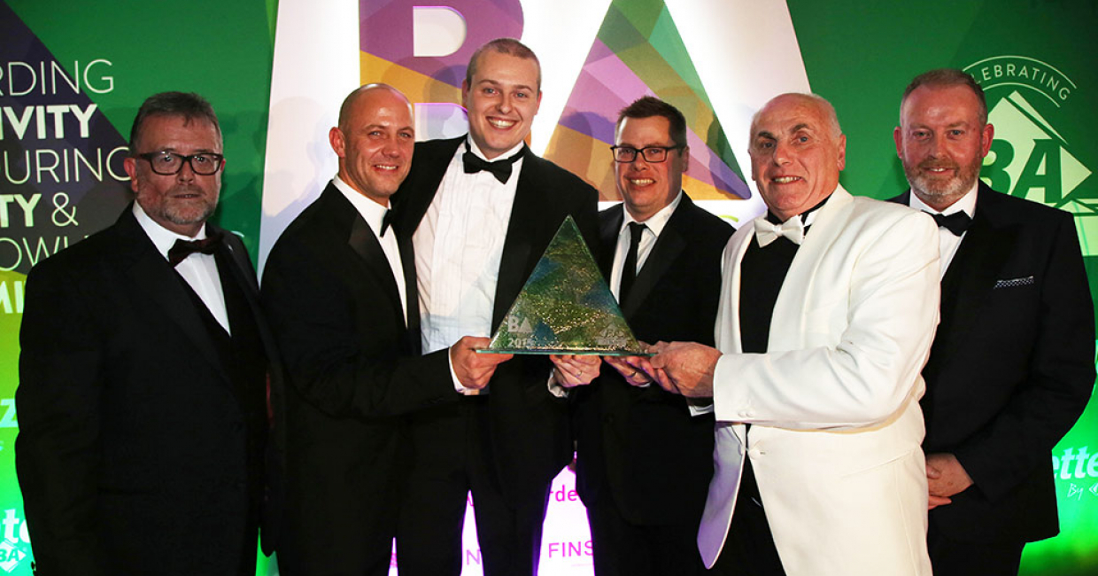 Matt Scaife of Unilin presenting the Best Use of Social Media Award to J Sheppard & Sons