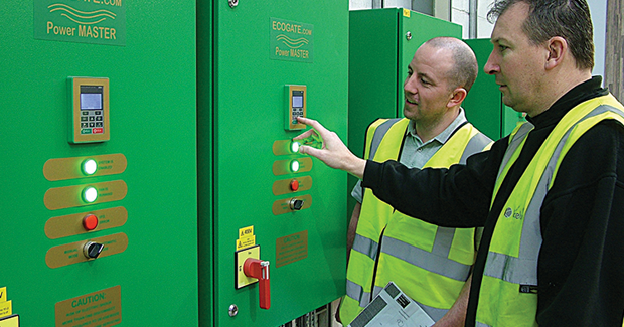 Kevin Lumb points out power savings to production supervisor, Andrew McCormick