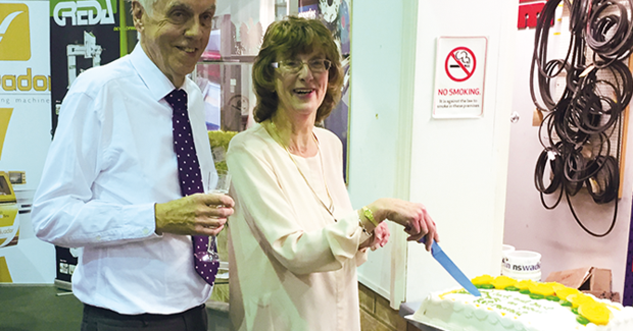 Carol and Francis Dalton with the retirement cake