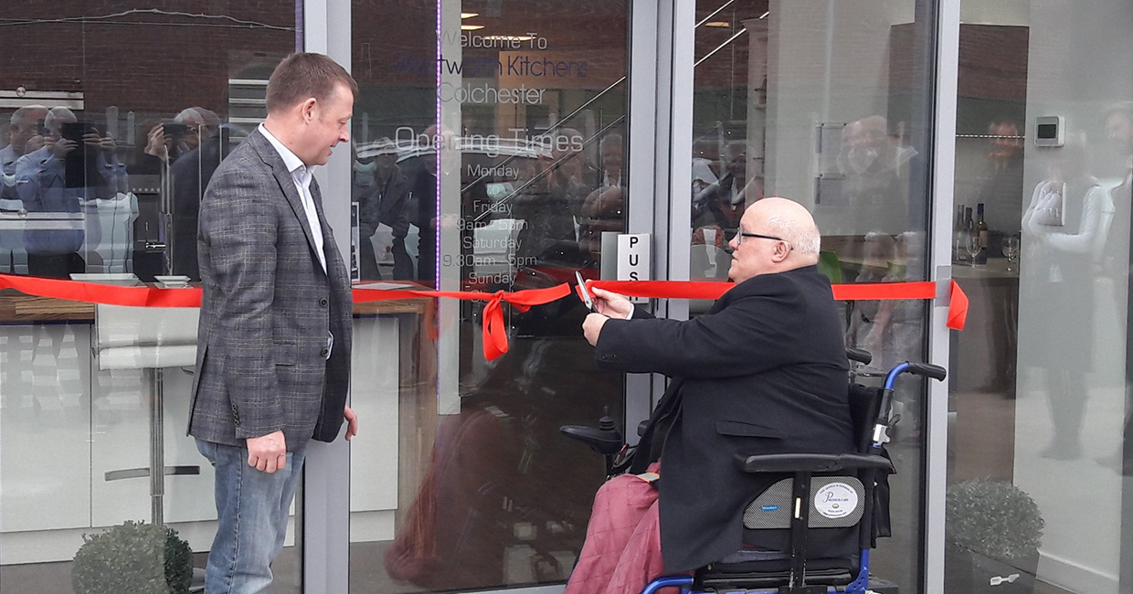 The Deputy Mayor of Colchester, Councillor Gerard Oxford, cuts the ribbon at the new Wentworth Kitchens showroom