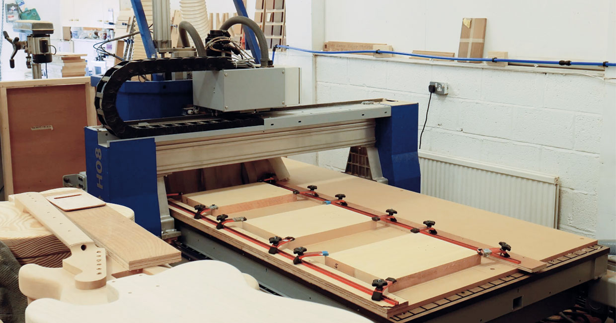 Neil Haynes guitar workshop proudly features a Felder Profit H08 CNC machinery