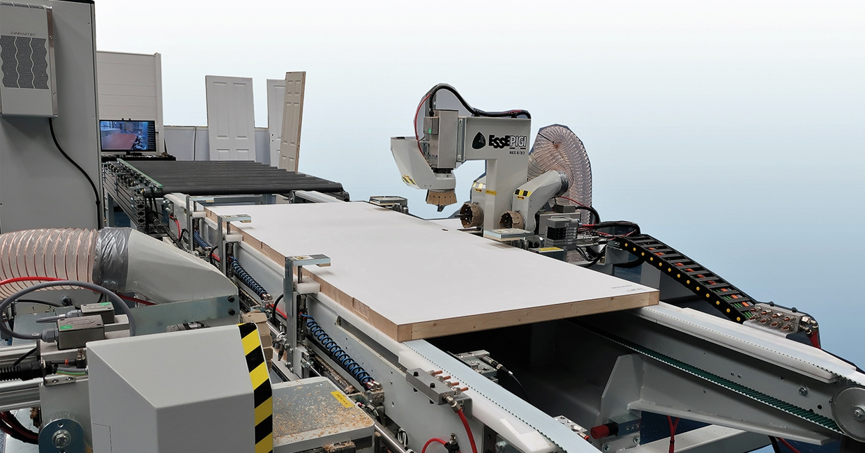 The Essepigi Doormatic Evolution high speed through-feed CNC working centre for door production