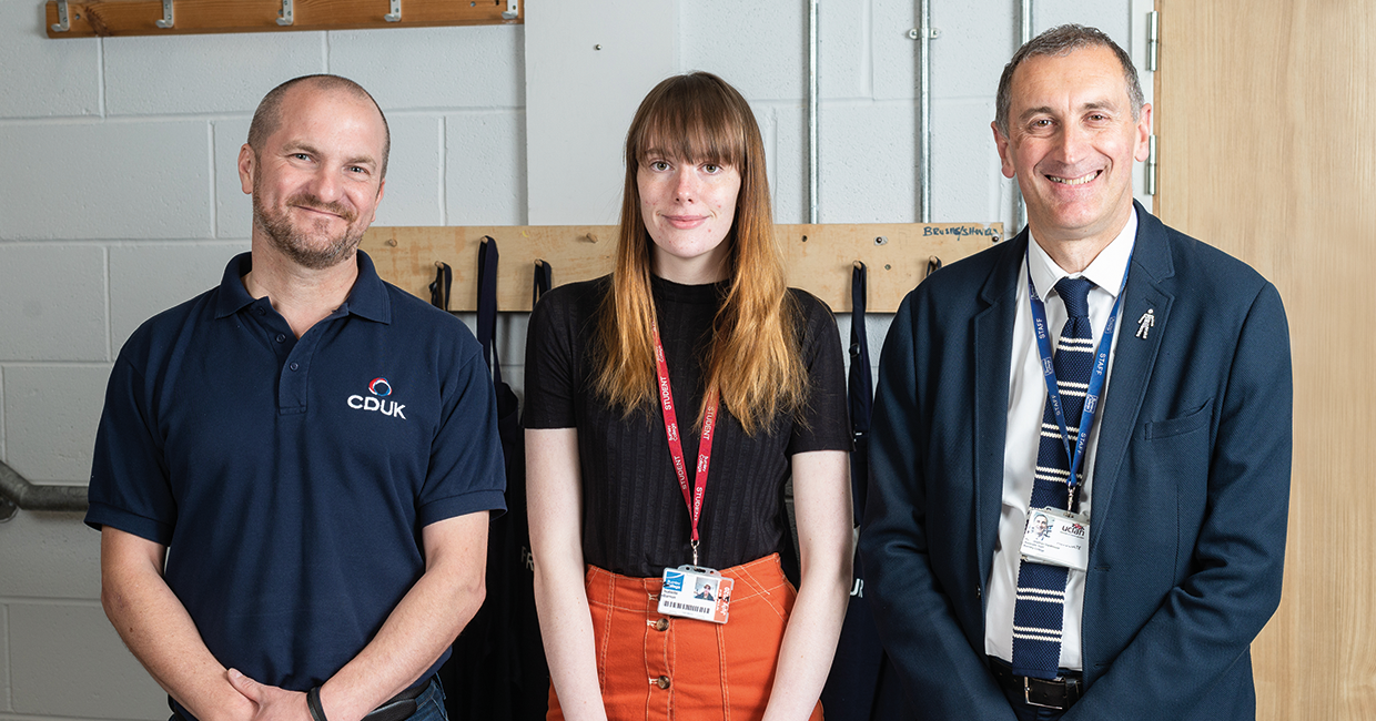 Isabelle Barron with her Corian desk, with Peter Watson of CDUK, left, and Tutor Paul Stackhouse