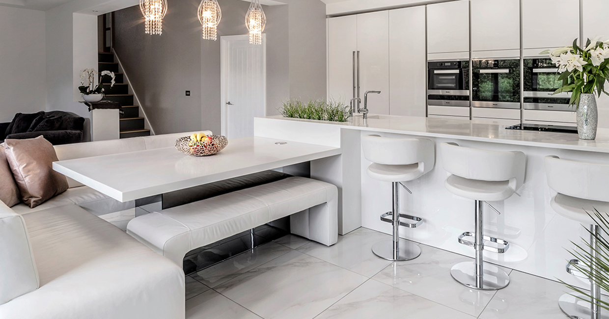 From the 2019 Cover Star competition: an elegant kitchen/living design by Arthouse Creative Interiors Ltd., with Corianfabricated by Bluestone Worktops Ltd