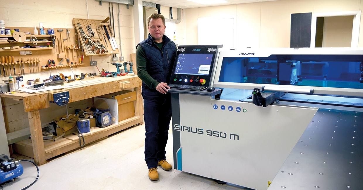 Simon Lewis with the AES Sirius 950M, cheek by jowl with a classic workbench