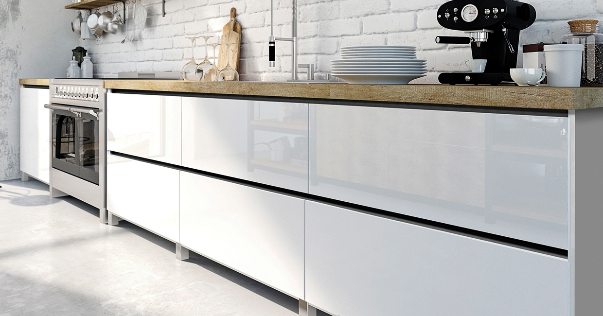Dark recessed handles give an elegant touch to furniture with bright surfaces