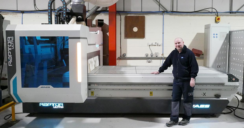 Matt Crowley with its AES Raptor Ultra 1632 CNC machine