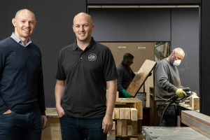 Factory investment applies expert finish for furniture maker