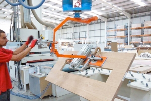 Vacuum tube lifting for industrial wood processes